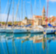 Reflection of sailing boats anchoring in