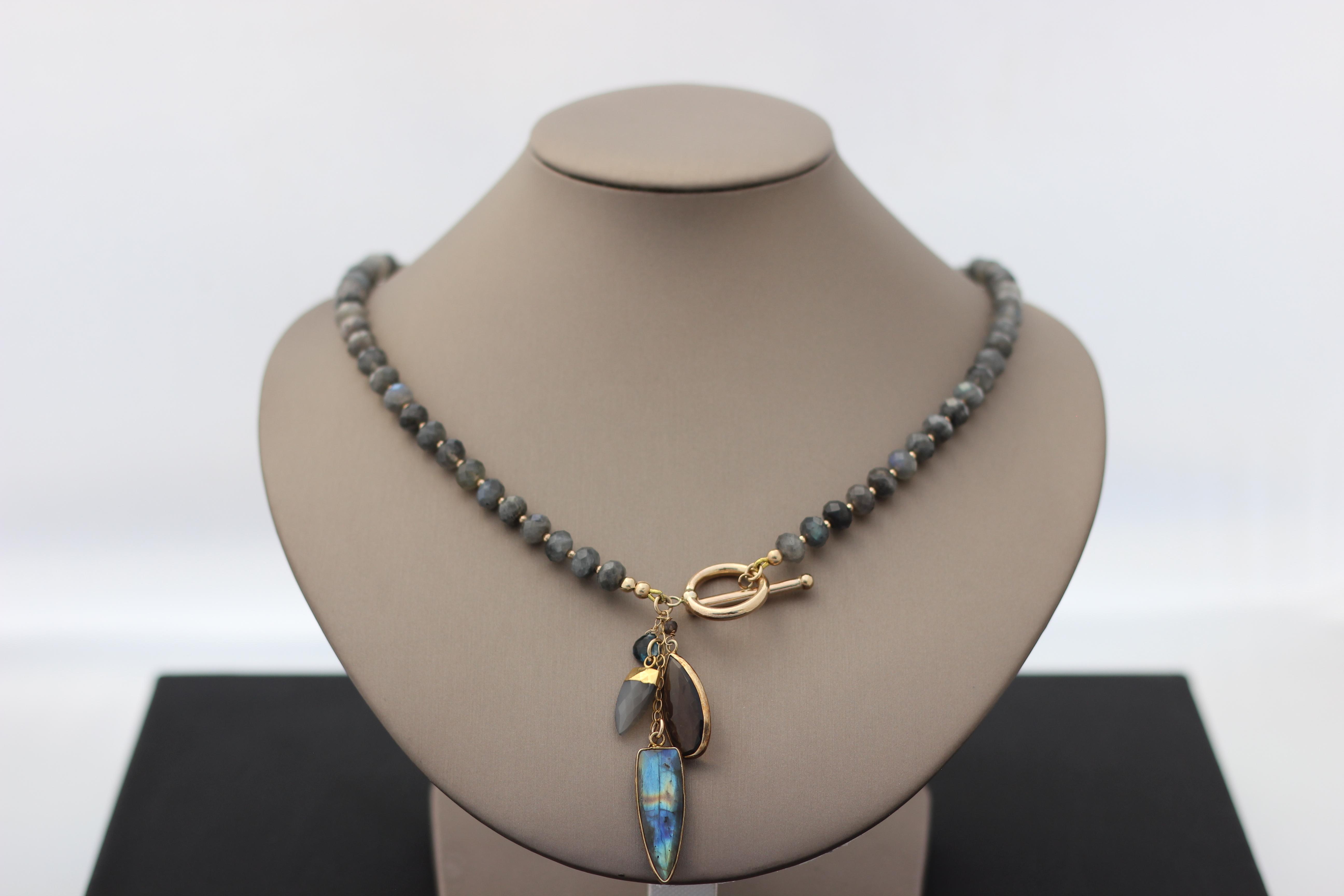 12. Labradorite, Smoky Quartz, London Blue Topaz | $398