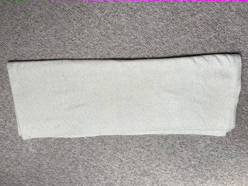 1. Unfold your blanket once, so that it opens into a longer, thinner fold.
