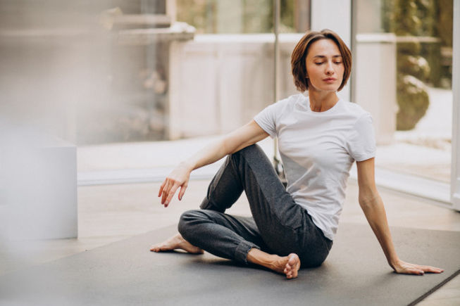 young-woman-practicing-yoga-home_1303-20