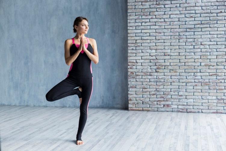 woman-standing-tree-yoga-pose_23-2148258