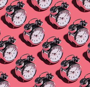 alarm-clocks-pink-background_23-21477440