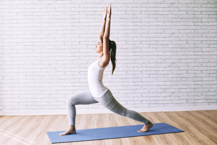 side-view-fit-girl-practicing-yoga-doing