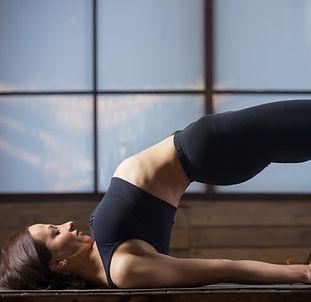 young-attractive-woman-glute-bridge-pose