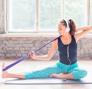 woman-exercising-with-yoga-strap-exercis