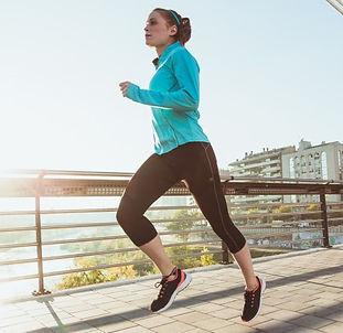 young-sportswoman-running_23-2147600465.