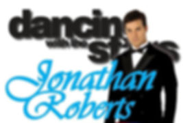 Dancing with the star champion, Johnathan Roberts poses in a black suit and tie
