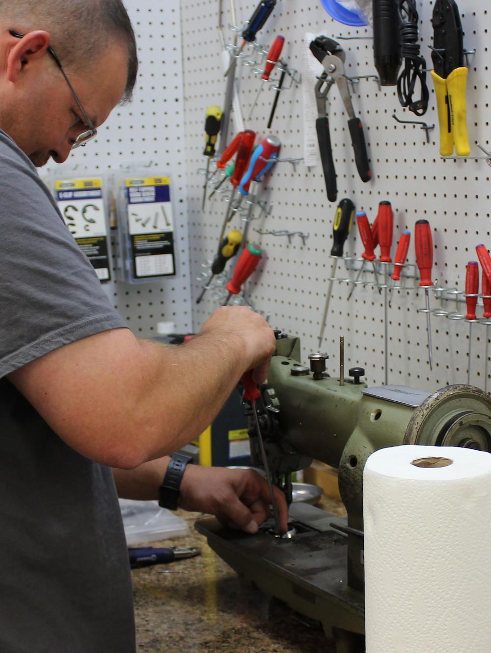 Greg Repairs an industrial machine.