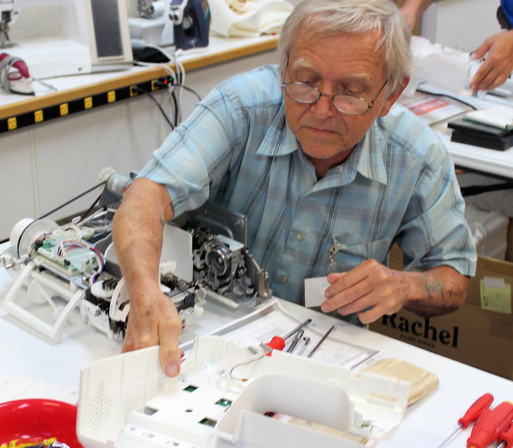 Arnold masters sewing machine repair.