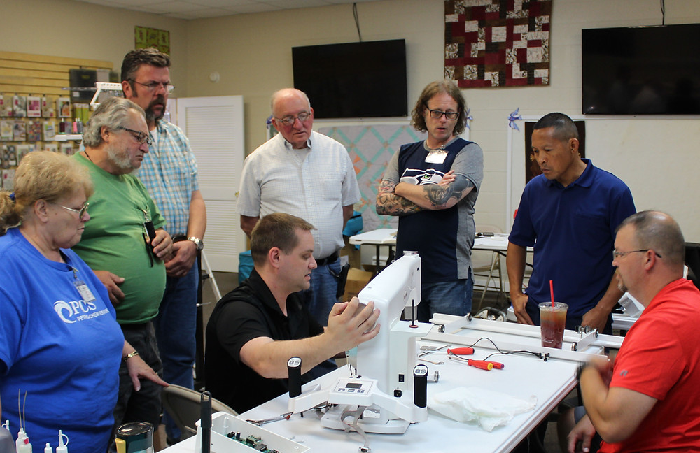 Students learn long arm quilting machines.