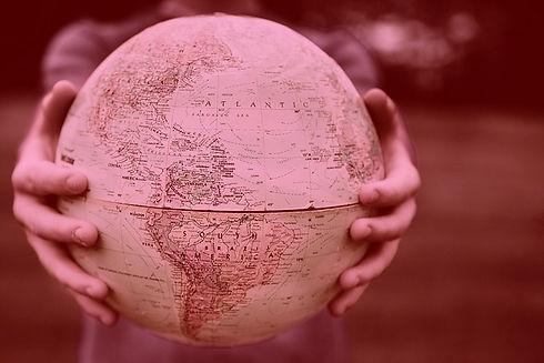 woman-holding-a-globe1_edited.jpg