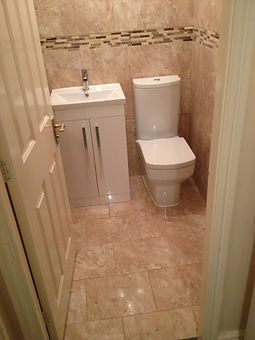 tiling and new toilet and sink in small space.jpg