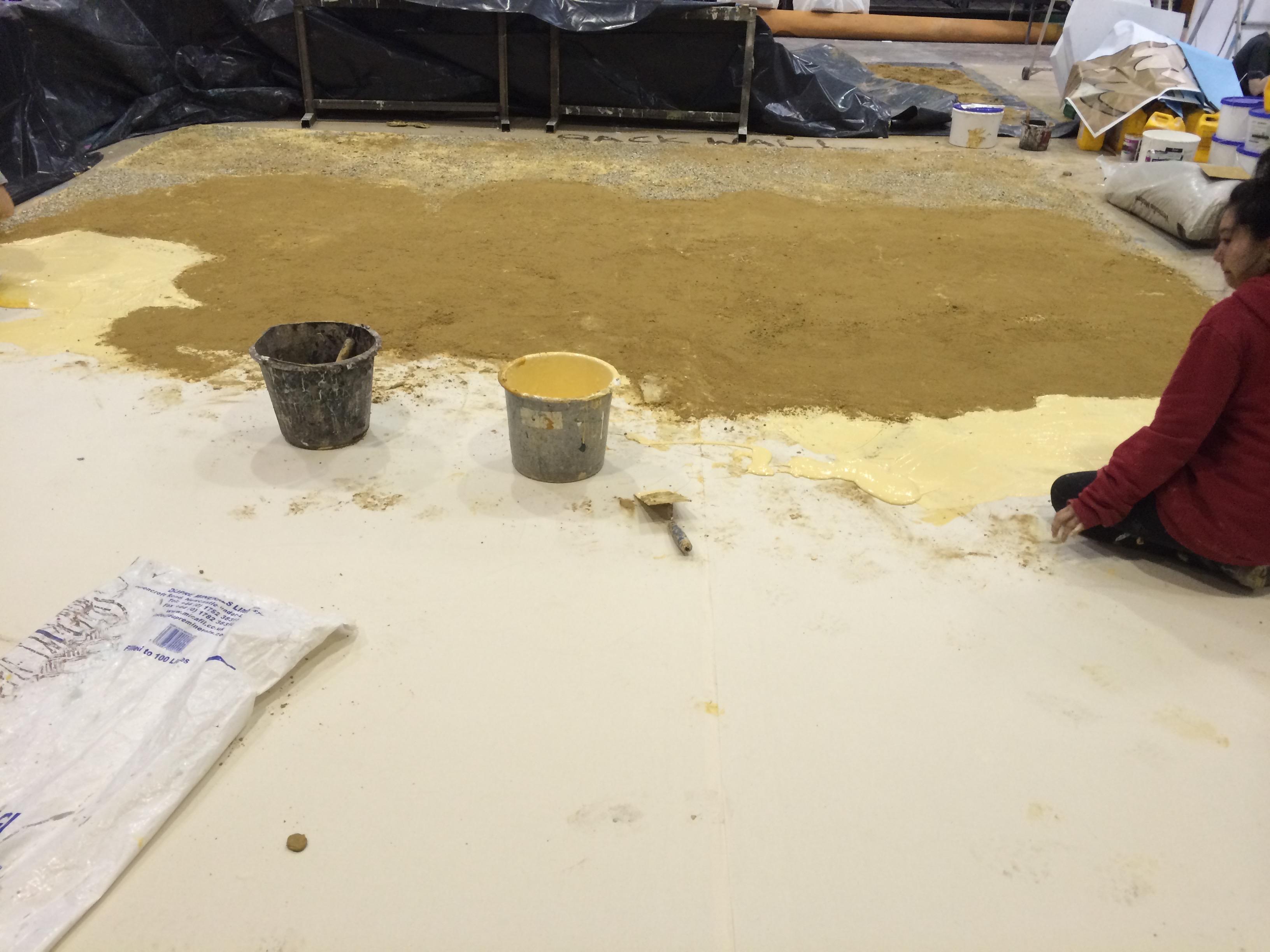 creating textured sand floor cloth