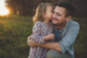 Father and daughter hugging after applied analysis behavior services