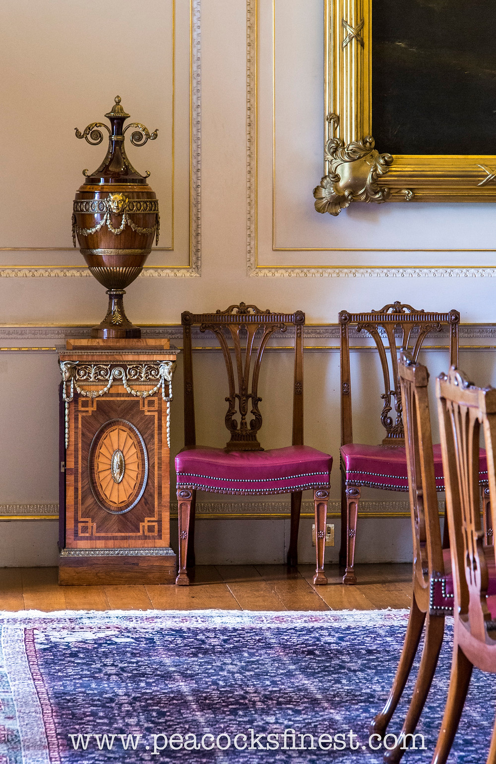 Harewood House, The State Dining Room. The fine set of Neoclassical dining-chairs and superb pair of urns, mounted onto pedestal plate-warmers, ensuite with a pair of serving-tables