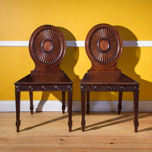 Pair of George III Hall Chairs, attributed to Mayhew & Ince