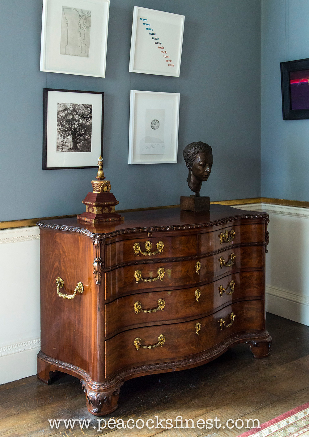The magnificent commode by William Vile was brought by Princess Mary from St James's Palace.