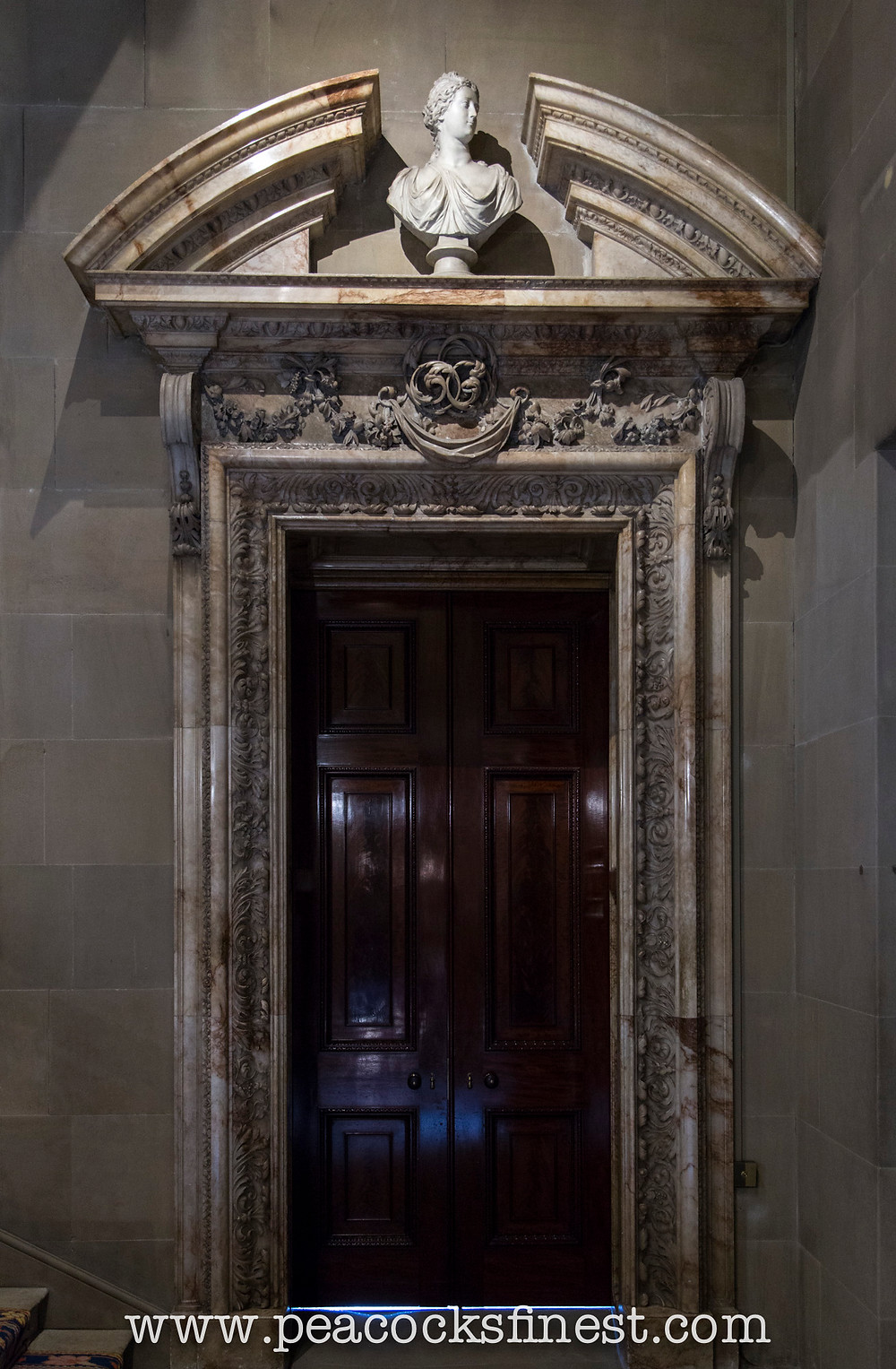 Carved marble baroque door surround at Chatsworth House