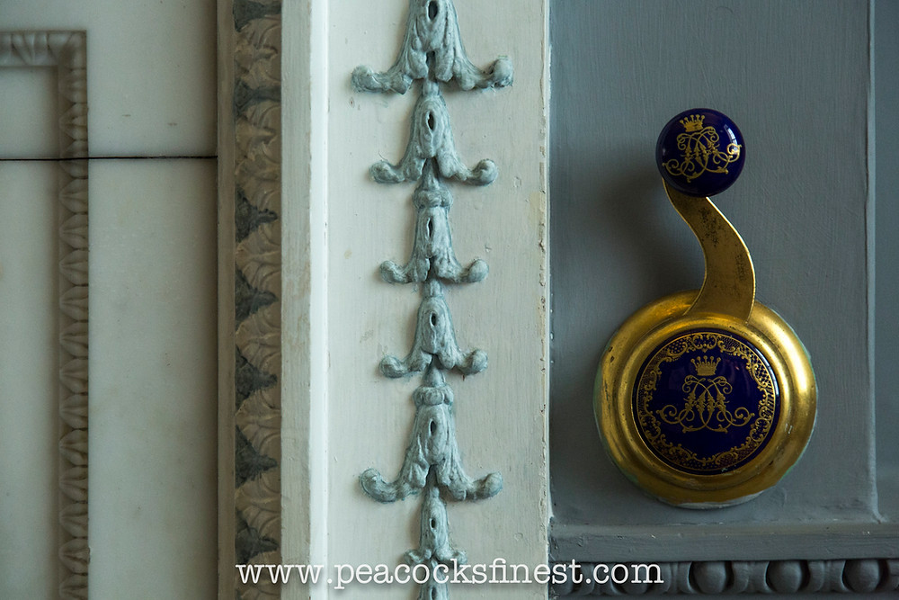 Harewood House, the Watercolour Room. A detail of the fireplace and ornate handle