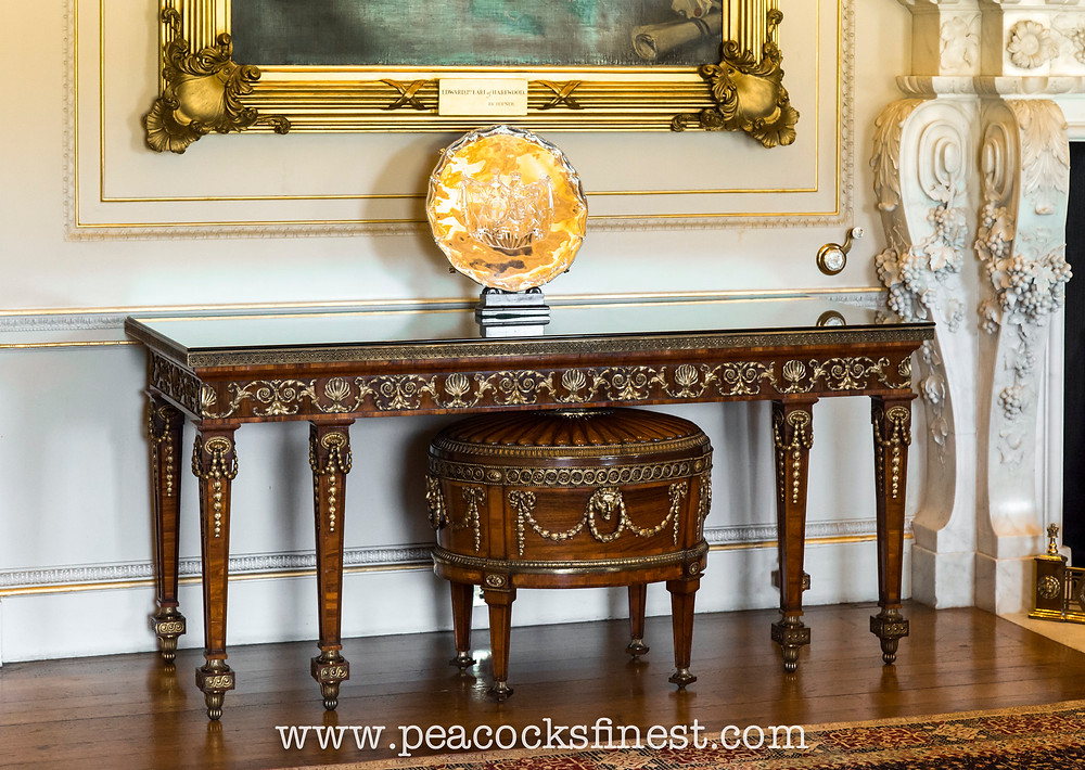 Harewood House, The State Dining Room. The superb gilt-metal mounted Neoclassical serving-table (one of a pair), and the magnificent wine cooler are among the finest pieces ever made by Chippendale's firm
