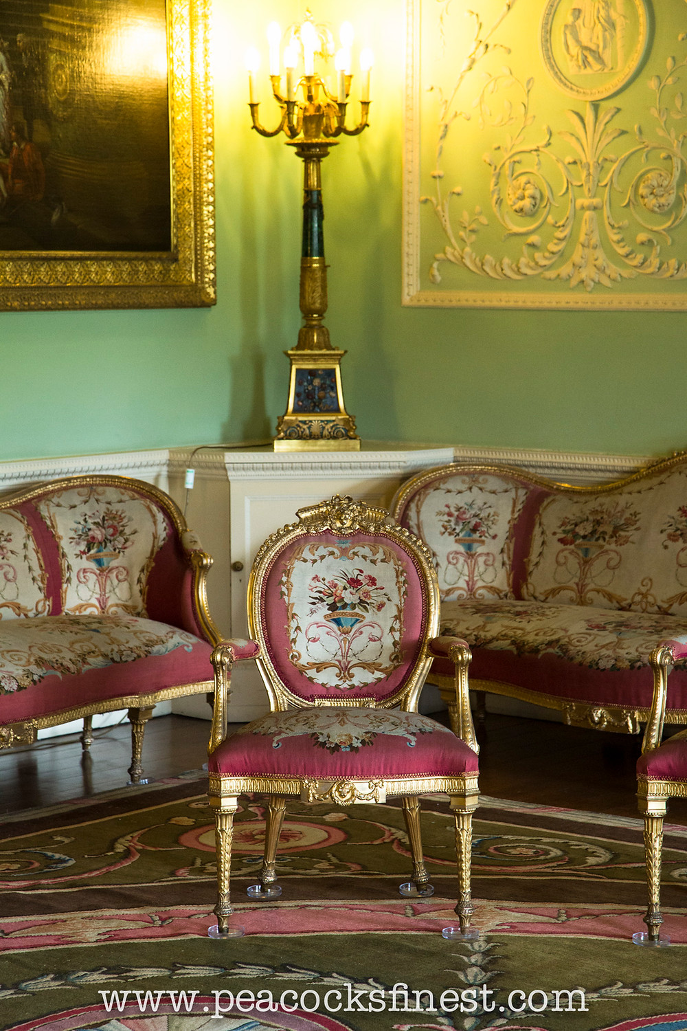 Harewood House, The Music Room. One of a set of eighteen George III giltwood open armchairs by Thomas Chippendale