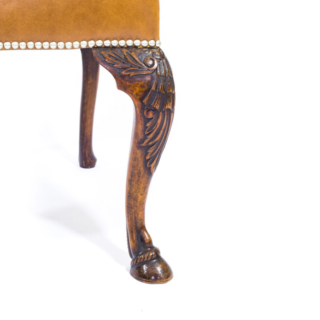 A leg detail of the offered chairs