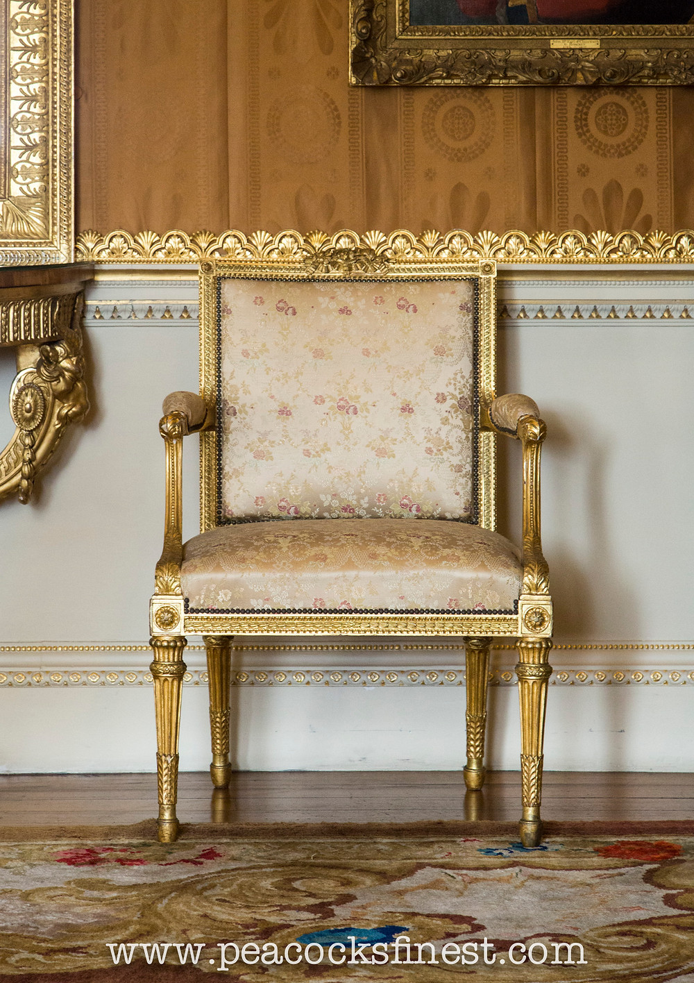 Harewood House, The Cinnamon Drawing Room. A fine giltwood open armchair, one of a suite of exquisite seat furniture in the Neoclassical taste.