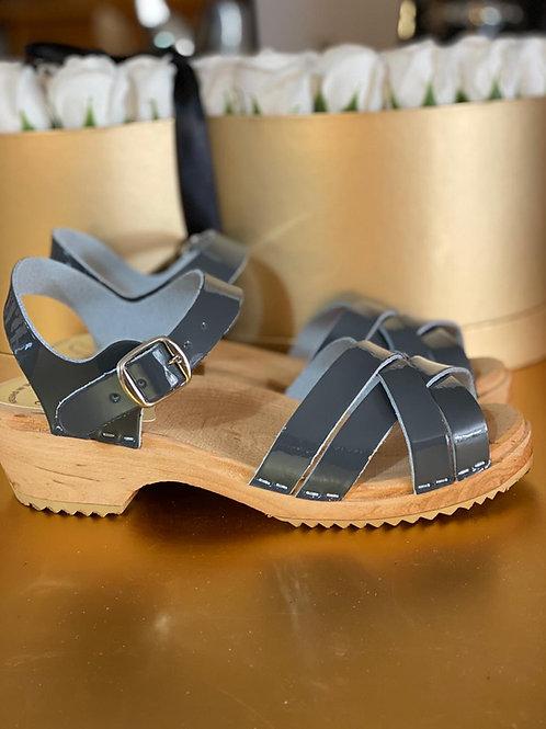 Low heeled sandal, gray gray nail polish.