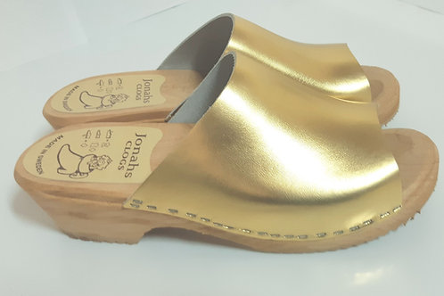 Open- low-heeled gold clogs