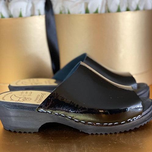 Black sandal clogs black nail polish