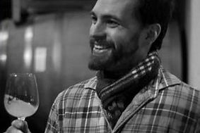 Phil Arras, Winemaker, ejoyinga glass of wine in the Finger Lakes.
