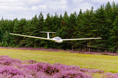 PK on aerotow over heather banks