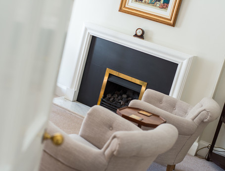 Fireplace and armchairs