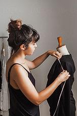 young fashion designer taking measures o