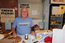 Arthur selling cheese