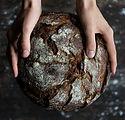 pexels.human-holding-a-bread-745988.jpg