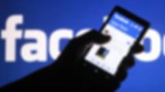 Facebook-user-on-mobile-phone.jpg