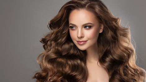 Beautiful model girl with long wavy and
