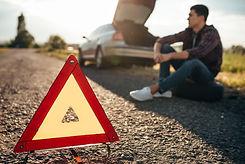 broken-car-concept-breakdown-triangle-on