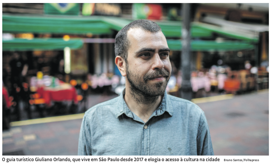 Giuliano Orlando standing outside a restaurant in a square of Sao Paulo