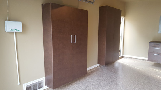 Full garage makeover, garage cabinets, polyaspartic floor coating, handiwall and paint.  Free estima