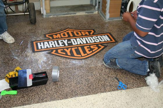 Logo installation on epoxy or polyaspartic floor coatings