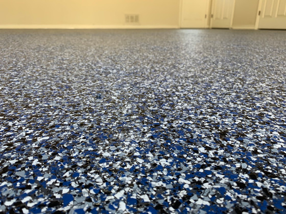What a difference a great epoxy coating makes in an old dirty garage floor.