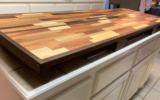 Butcher block over stove burners to create more countertop space