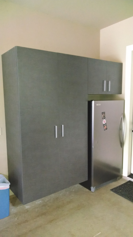 Garage cabinet for hanging extra clothes