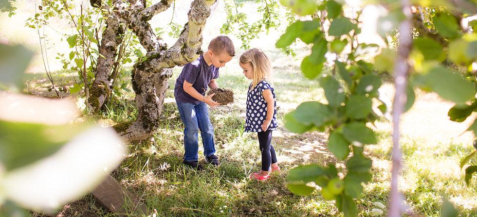 kids-under-tree-looking-at-birds11-nest-