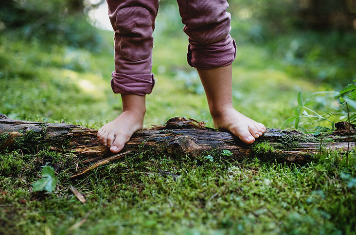 bare-feet-of-small-child-standing-barefo