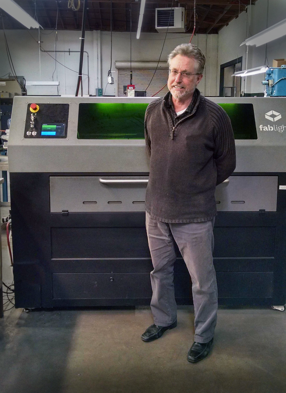 Dan Morgan standing next to the FabLight machine at Scandic Springs