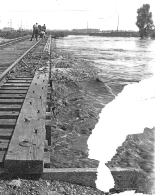 Workers Securing the Railroad bridge over the North Fork of the Yellow Medicine River. This photo is taken from the Porter side of the river looking East.