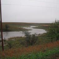 What is normally a small stream just a couple feet wide becomes a swelled raging river in the hills west of Porter